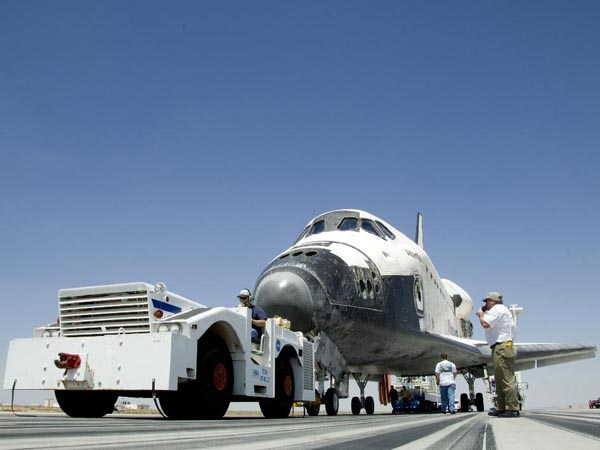 Ground crews begin towing Space Shuttle Atlantis from the main runway at Edwards Air Force Base following its landing May 24, 2009, which concluded the STS-125 mission to upgrade the Hubble Space Telescope.  (http://www.nasa.gov)