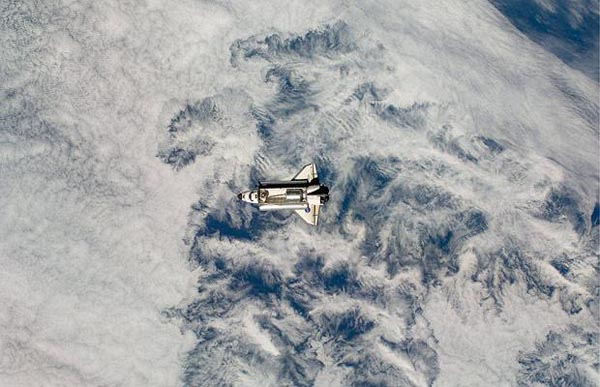 Space Shuttle Endeavour approaches the International Space Station with its cargo bay doors open and the Leonardo Multi-Purpose Logistics Module visible inside the shuttle's cargo bay. (http://www.telegraph.co.uk)