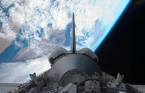 Backdropped by the Earth, the Leonardo Multi-Purpose Logistics Module, a large pressurised container used to transfer cargo to and from the International Space Station, is visible in the shuttle's payload bay. (http://www.telegraph.co.uk)